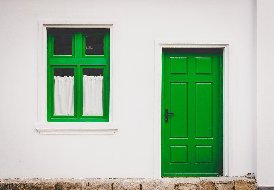 Home with a green door.