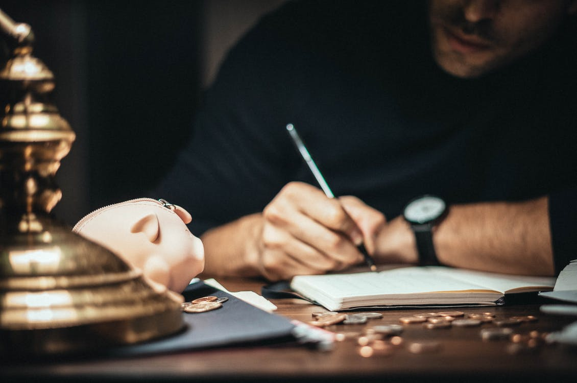 Crop banker taking notes in account book