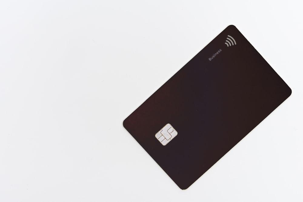 black asus laptop computer on white surface